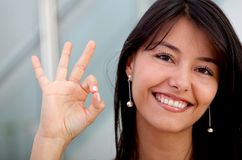 Business woman making an ok sign Royalty Free Stock Image