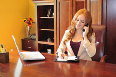 Business woman making a phone call Royalty Free Stock Photo