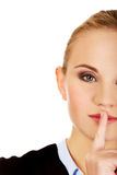 Business woman making silent sign with finger on lips Royalty Free Stock Images