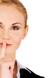 Business woman making silent sign with finger on lips Stock Photography