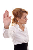 Business woman making stop. Serious business woman making stop sign over white, focus on hand Stock Photo