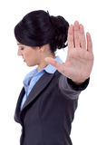 Business woman making stop sign. Serious business woman making stop sign over white, focus on hand Stock Photo