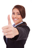 Business woman making thumb up ok gesture. Young business woman making thumb up ok gesture. Isolated over white background Stock Images