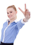 Business woman making victory gesture Stock Photo