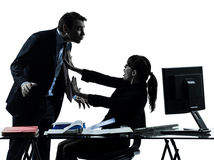 Business woman man couple sexual harassment silhouette Stock Photography