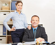 Business woman and man at desk in their office Royalty Free Stock Photo