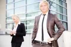 Business woman man digital tablet Stock Photos