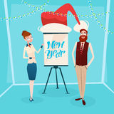 Business Woman And Man With Flip Chart Santa Hat New Year Celebration Stock Images
