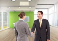 Business woman and man handshake at the arrive to the office. Digital composite of business women and men handshake at the arrive to the office Stock Image