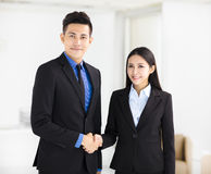 Business woman and man handshaking in office Royalty Free Stock Photography