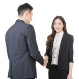 Business woman and man shake hands Royalty Free Stock Images