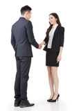 Business woman and man shake hands Royalty Free Stock Photography