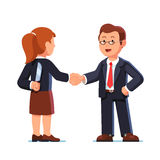 Business woman and man shaking hands. Betrayal. Business woman and man standing together and shaking each other hands while one holding knife behind back Stock Image