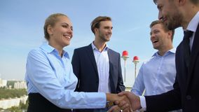 Business woman and man shaking hands, work partners applauding celebrating deal stock video footage