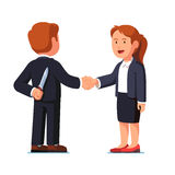 Business woman and man standing shaking hands. Business woman and man standing together shaking hands. Businessman holding knife behind his back. Treacherous Royalty Free Stock Photos