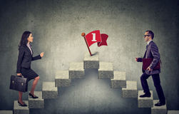 Business woman and man stepping up a stairway career ladder Stock Images