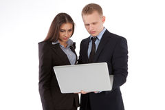 A business woman and man working together on a laptop Stock Photo