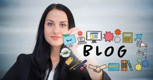 Business woman with marker behind blog doodles with flare against blurry grey wood panel Stock Photography