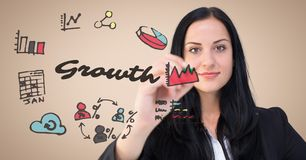 Business woman with marker behind growth doodles against cream background stock image