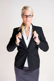 Business woman with masculine posture. Royalty Free Stock Photography