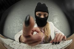 Business woman, masked, steals data stock photo