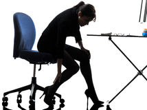 Business woman massaging her leg silhouette Royalty Free Stock Photo