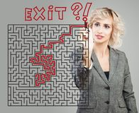 Business woman and maze background. Success, planning, problem and solution concept royalty free stock photography