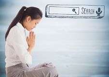 Business woman meditating against blurry blue wood panel with search bar Stock Photo