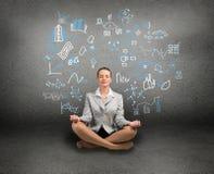 Business woman meditating on floor Royalty Free Stock Photos