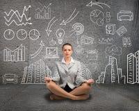 Business woman meditating on floor Stock Photos
