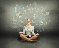 Business woman meditating on floor Royalty Free Stock Photography