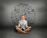 Business woman meditating on floor Royalty Free Stock Images