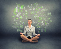 Business woman meditating on floor Royalty Free Stock Photo