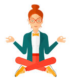 Business woman meditating in lotus pose Royalty Free Stock Photo