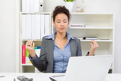 Business woman meditating. At the office Royalty Free Stock Photos