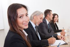 Business Woman In Meeting With Colleagues Stock Image