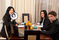 Business woman at meeting with megaphone Royalty Free Stock Image
