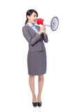 Business woman with megaphone yelling. And screaming isolated on white background, asian model Royalty Free Stock Images