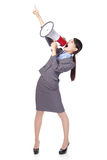 Business woman with megaphone yelling and pointing. Business woman with megaphone yelling and finger pointing to empty copy space isolated on white background Stock Image