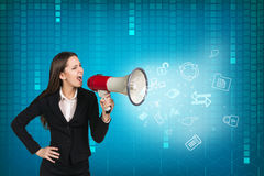 Business woman with megaphone is yelling Stock Image