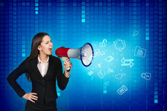 Business woman with megaphone is yelling Stock Photos