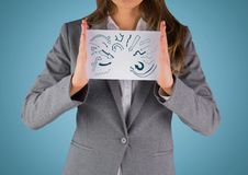 Business woman mid section with card showing blue arrow doodles against blue background Royalty Free Stock Photography