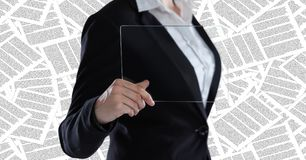 Business woman mid section with glass device against documents backdrop Stock Photos