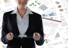 Business woman mid section with glass tablet against documents backdrop Stock Photos