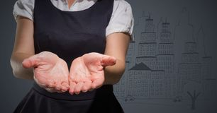 Business woman mid section with hands out against grey background with city doodle Stock Photography