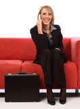 Business woman on mobile phone. While sitting Royalty Free Stock Photos
