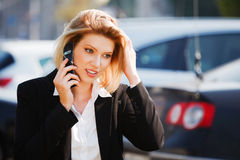 Fashion business woman calling on the cell phone Royalty Free Stock Images