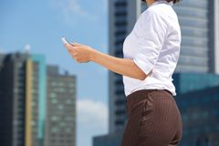 Business woman and mobile phone in the city Royalty Free Stock Photos