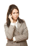 Business woman with mobile phone look in camera Royalty Free Stock Photos