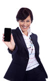Business woman with mobile phone. Smiles Royalty Free Stock Photography